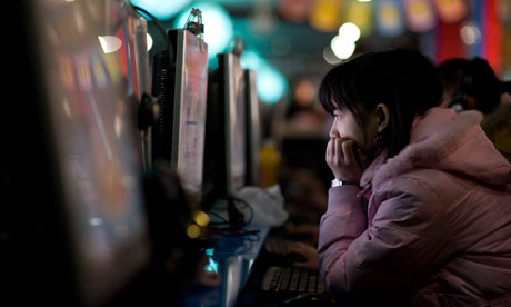 Chinese woman in internet cafe